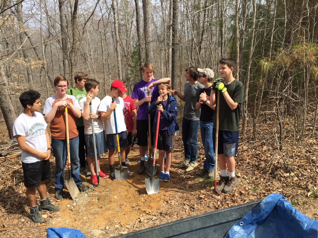 Amado and Scouts repairing Carrboro HS cross-country trail
